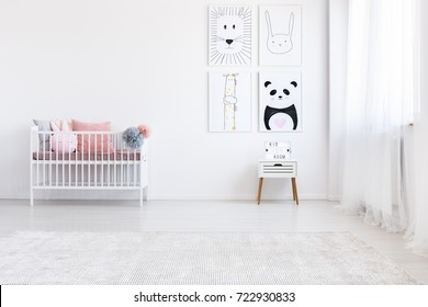 Panda drawing on wall above white cabinet in girl's bedroom with pink pillows on bed
