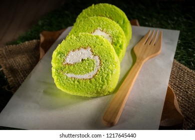 Pandan cream roll cake, bakery pastry, Sponge roulades with cream and fresh Pandan, selective focus, copy space