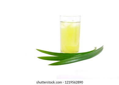 Pandan Juice in glass with green pandan leaves isolated on white background, herbal soft drink