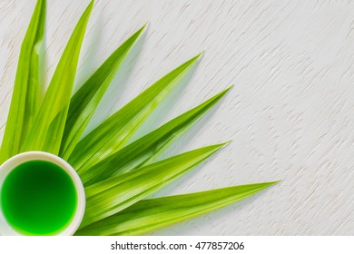 Pandan Juice and Pandan Leaves,Pandan Juice In Glass And Pandan Leaves , Pandan healthy drink water on basket