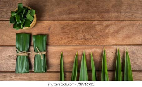 Pandan and pandan leaves in a wooden cup prepared for pandan juice or pandan cake to boil or dried Before going to cooking.Shot in the studio.top viewShot in the studio
