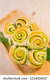 Pandanus bun, Fresh bakery pastry and pandan leaf on wooden background, selective focus, copy space