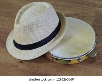 A pandeiro (tambourine), a Brazilian percussion musical instrument, and a samba player (sambista) hat. The instrument is widely used to accompany samba and choro, two popular Brazilian rhythms.