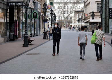 Pandemic Coronavirus (COVID-19), people in city street wearing face mask protective for spreading of Coronavirus Disease at March 28, 2020 in Budapest, Hungary.