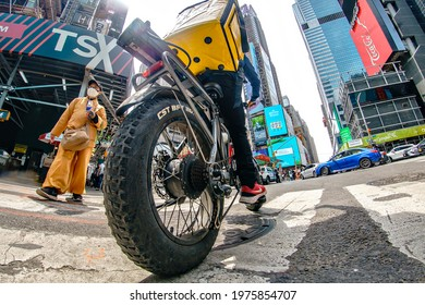 Pandemic Food Delivery on a bike, Times Square, New York City, Manhattan, New York, United States, 5.15.2021