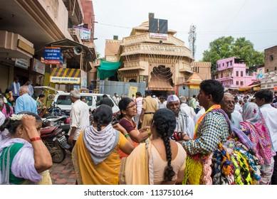 Pandharpur / India 16 July 2018 Indian people buying Outdoor Garden Hanging Hammock Swing in front of Vitthal temple at Pandharpur Maharashtra India