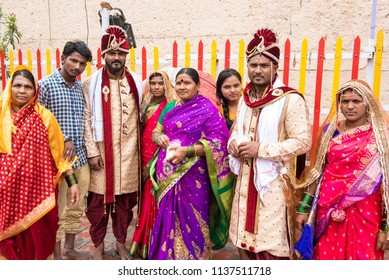 Pandharpur / India 16 July 2018 Group photograph of newly Married Indian Maharashtrian couple and family near Vitthal temple at Pandharpur Maharashtra India
