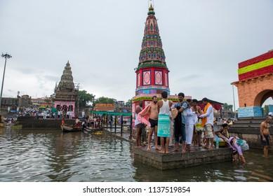 Pandharpur / India 16 July 2018 Crowd at river Chandrabhaga near Pundalik Temple  in Ashadhi Ekadashi indian festival at  Pandharpur Maharashtra India