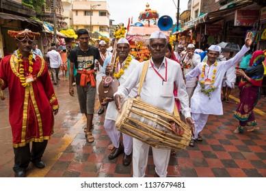 Pandharpur / India 16 July 2018 During Pandharpur wari procession Pilgrims marching toward Vitthala temple with singing religious song at Pandharpur Maharashtra India