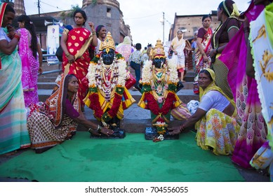 Pandharpur / India 25 August 2017 Devotees  worshiping idol of Lord Vitthal and goddess Rukhmai after holy Bath in River Chandrabhaga at Pandharpur Maharashtra  India