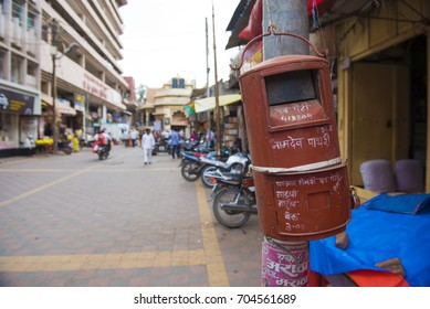 Pandharpur / India 25 August 2017 Old red round Indian post box outside the Vitthal temple at Pandharpur in Solapur district  Maharashtra  India