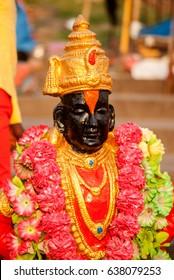 PANDHARPUR INDIA - March 26, 2015: Lord Vitthal Statue at Bhima River banks, Pandharpur, Solapur District, Maharashtra, India, Southeast, Asia.