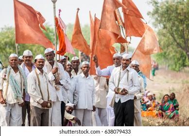 PANDHARPUR INDIA - March 26, 2015: Devotee called VARKARI with flag going to Pandharpur VARI Solapur District, Maharashtra, India, Southeast, Asia.