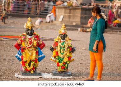 PANDHARPUR INDIA - March 26, 2015: God and Goddess Vitthal Rakhumai Statue at Bhima River banks, Pandharpur, Solapur District, Maharashtra, India, Southeast, Asia.