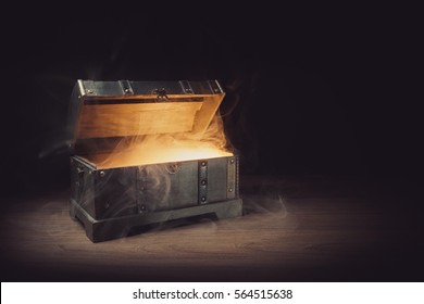 pandoras box with smoke on a wooden background