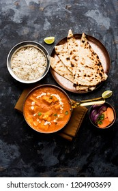 Paneer Butter Masala or Cheese Cottage Curry in serving a bowl or pan, served with or without roti and rice