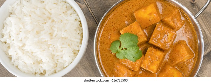 Paneer Makhani or Shahi Paneer (Paneer Butter Masala) - Indian curd cheese curry served in a balti dish and garnished with coriander leaves. Shot from above (overhead).