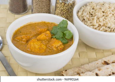 Paneer Makhani or Shahi Paneer (Paneer Butter Masala) - Indian curd cheese curry served with chapatis and pilau rice.