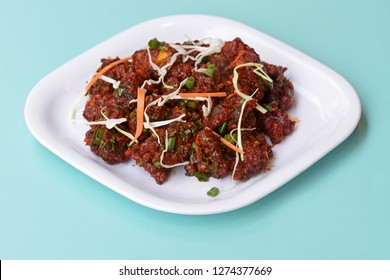 Paneer Tikka Kabab in red sauce - is an Indian dish made from chunks of cottage cheese marinated in spices ,chilli Paneer Kabab, Paneer 65,Spicy cottage cheese