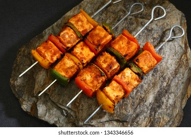 Paneer Tikka Sizzler served on the stone plate - Cottage Cheese served with sauce
