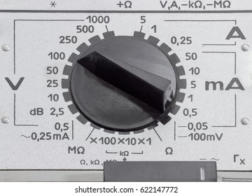Panel of the analog multimeter older design with two mode switches various designs closeup