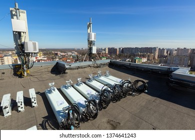 Panel antennas of GSM DCS UMTS LTE bands and outdoor radio units are as parts of communication equipment of basic station are prepared to installed on the roof and sky and city are as background