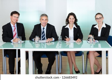Panel of corporate personnel officers sitting at a table