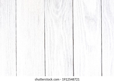 Panel from the old, shabby boards of white color, located apeak as a background.