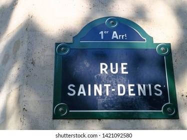 Panel on a stone facade: Rue Saint Denis. Paris