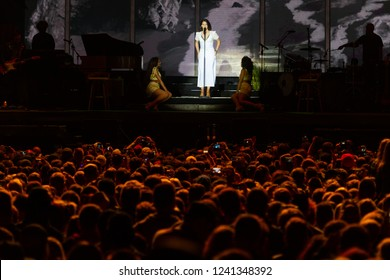 PANENSKY TYNEC, CZECH REPUBLIC - JUNE 29, 2018: Famous American singer Lana Del Rey (in the middle) during her performance at Aerodrome festival in Panensky Tynec, Czech Republic, June 29, 2018.