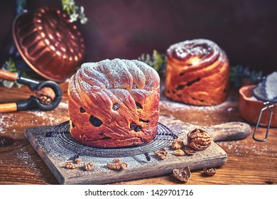 Panetone kulich craffin in vintage dark rustic scene. Easter bread kozunak. Wood table copy space concept.