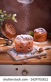 Panetone kulich craffin in vintage dark rustic scene. Easter Christmas bread kozunak. Wood table copy space concept.