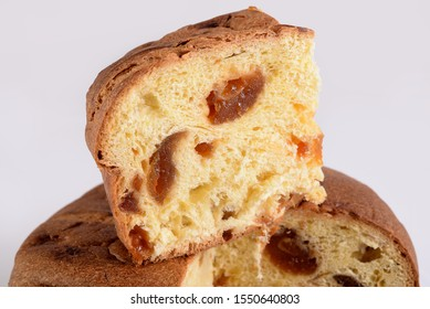 Panettone crafted with typical Italian apricot on a white background