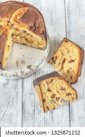 Panettone on the white wooden background: cross section