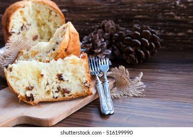 Panettone, Traditional Italian Christmas cake  on rustic background with vintage fork. Copy space.