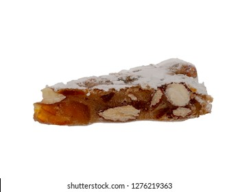 Panforte slice, isolated on white, Italian Christmas sweet dessert, cake make with dried fruits and nuts.