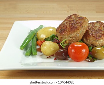 pan-fried danish dumplings or frikadeller with salads and vegetables