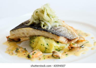 Pan-fried wild sea bass with fennel and herbs