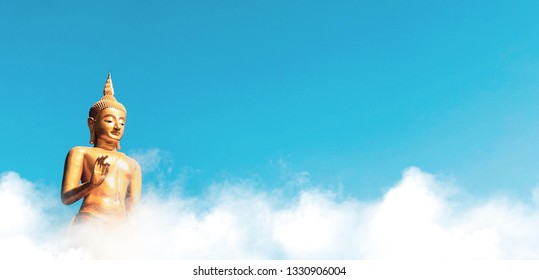 Pang Buddha Image style with clouds and blue sky background. Thai Buddha Statue Visakha Bucha day is the most important Buddhist holiday.