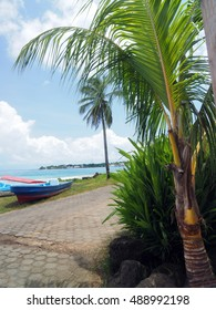 panga fishing speed boats roadside with capital Brig Bay Big Corn Island in background Nicaragua