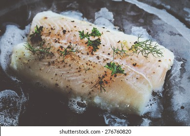 Pangasius fillet with spices and vegetables