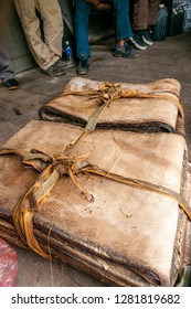 Pangi, Tenom, Sabah, Malaysia - July 3 2014: Bales of raw natural rubber sheets, packed with bark stripes, produced by smallholders of the Sabah River Valley, in a freight car of Sabah State Railways