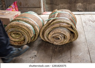 Pangi, Tenom, Sabah, Malaysia - July 3 2014: Bales of raw natural rubber sheets, produced by the local smallholders of the Sabah River Valley, were transported in a freight car of Sabah State Railways