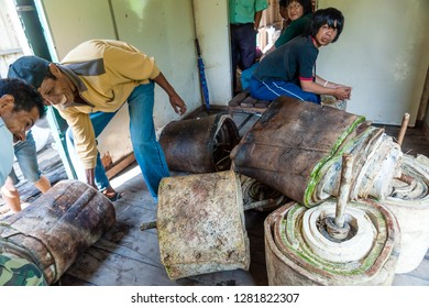 Pangi, Tenom, Sabah, Malaysia - July 3 2014: Bales of raw natural rubber sheets, produced by the local smallholders of the Sabah River Valley, were loaded into a freight car of Sabah State Railways
