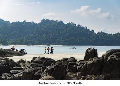 PANGKOR ISLAND, MALAYSIA - 17 DECEMBER 2017 : tourist enjoying island hoping beach activities at Pangkor Island, Malaysia