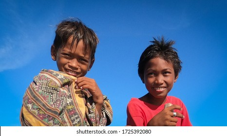 Panglao, Philippines, may 08.2020 At dawn, on a clear day, in the sea, on a fishing boat, local boys catch fish