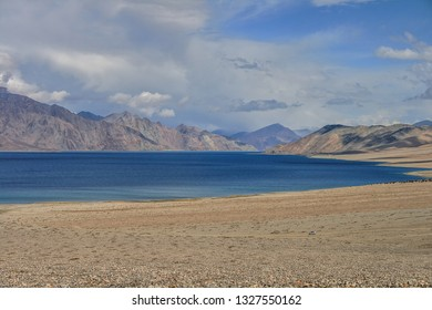Pangong Lake, Ladakh / India: A large oasis in the cold, desolate high mountain desert region of the Himalayas. Reflects, snow-peaks and ranges that surround it with stunning sand and rock formations