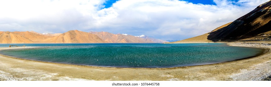 "Pangong Tso Tibetan for ""high grassland lake"" Pangong Lake, is an endorheic lake in the Himalayas situated at a height of about 4,350 m (14,270 ft)"