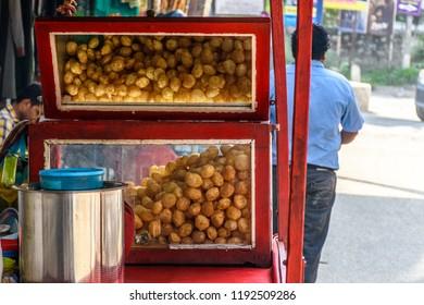 Pani Puri, Golgappe & Chat item steet vendor's stall in India