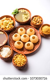 Pani Puri is Indian chat served in a terracotta bowls and plate